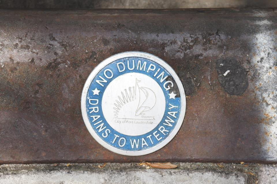 Storm drain marker close up