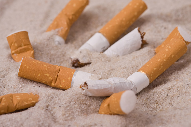 Cigarettes in the sand