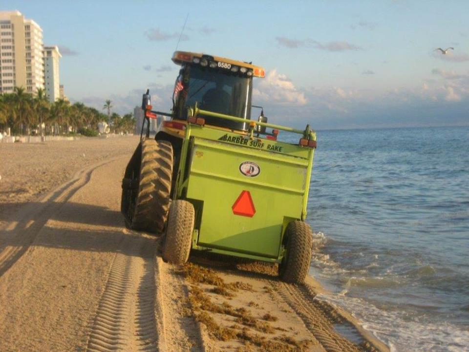 Tractor picking up seaweed
